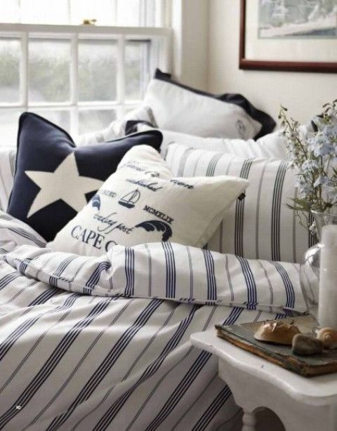 a nautical bedding set with stripes, stars and nautical prints