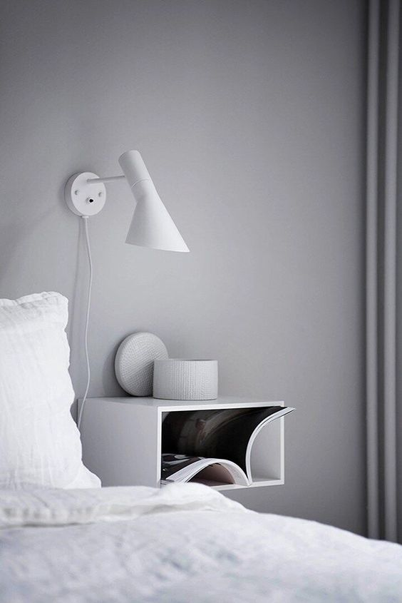a white open box bedside piece for a minimalist or Scandinavian bedroom