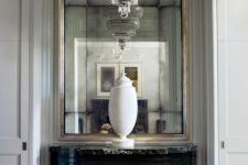14 oversized mirror in a metallic frame with a large vintage chandelier look exquisite and adorable