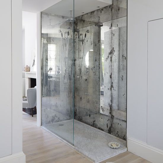 two silver faded mirror shower walls highlight this space and make it more special
