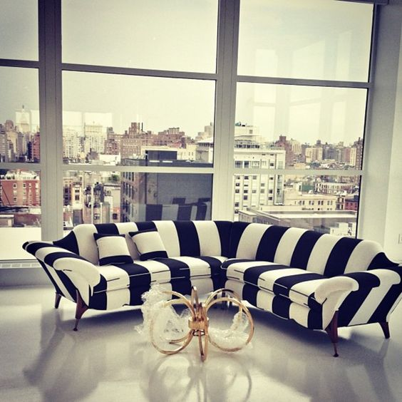 a black and white striped sofa looks quirky and cool, what can be better for a modern interior