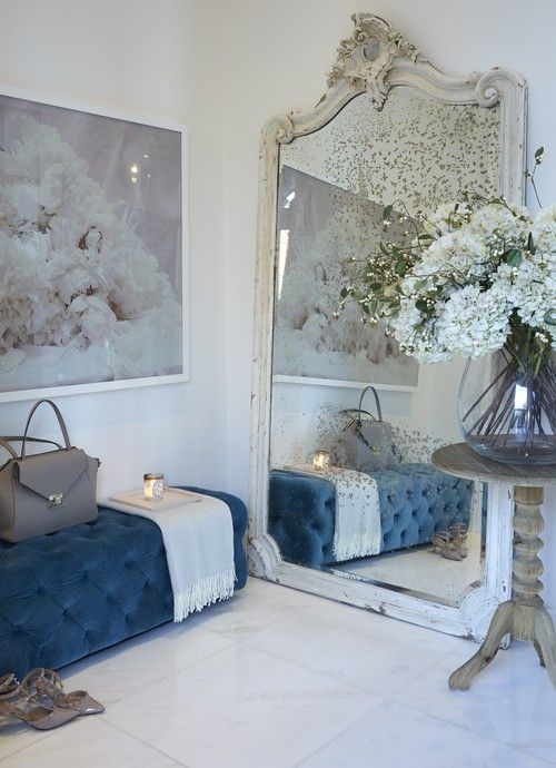 a faded mirror in a vintage white frame makes this girlish entryway refined