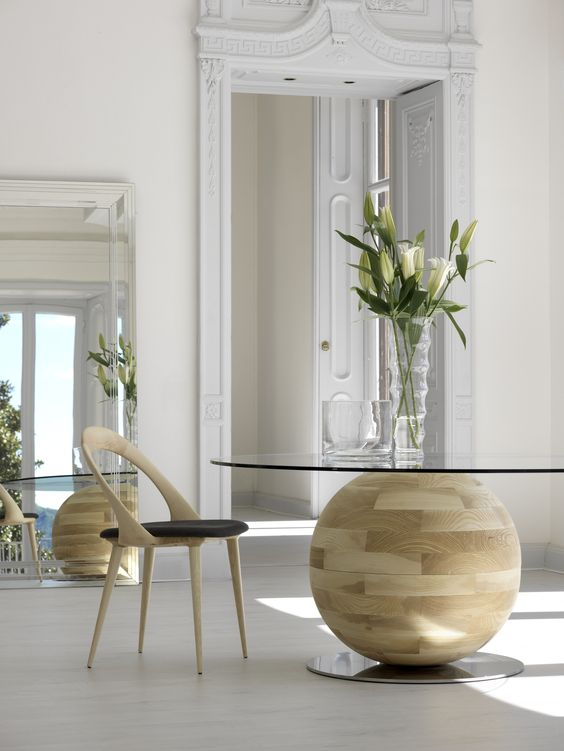 a round glass tabletop table with a unique wood ball base looks wow