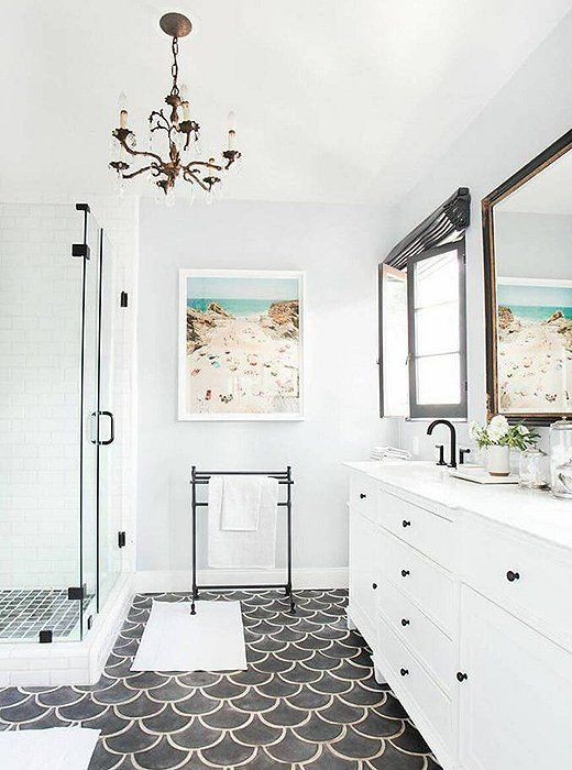 black fishscale tile floor creates a bold accent in this bathroom