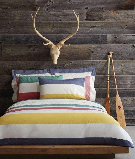 bring summer vibes to your bedroom with colorful striped bedding