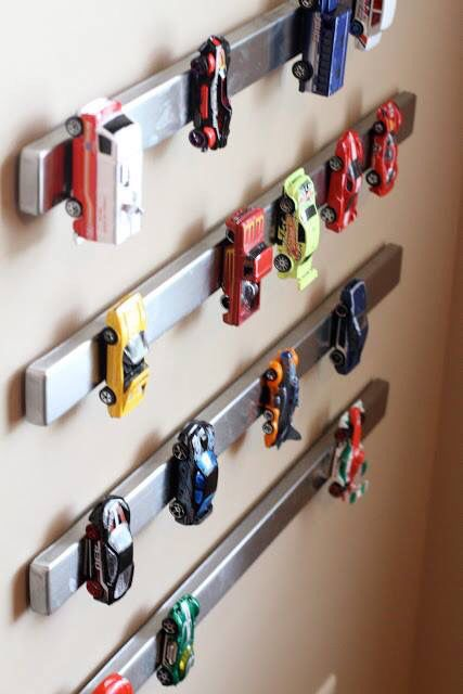 magnet toy car storage is a genius idea for a boy's playroom