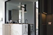 15 the sink zone is defined with a large wall mirror in a black frame