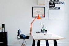 16 a modern laconic version of popular trestle desk – black legs and a wooden tabletop