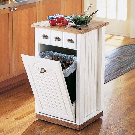 a tiny kitchen island with a tilt out trash can inside