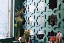 16 repeated wall mirrors in eye-catchy frames to fit a Moroccan bathroom