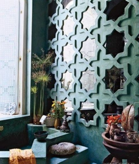 repeated wall mirrors in eye-catchy frames to fit a Moroccan bathroom