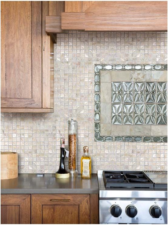 warm-stained wooden cabinets look organic and natural with mother of pearl tile backsplash