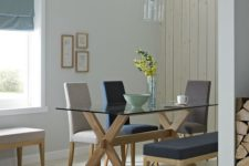 17 a trestle table with a glass tabletop and comfy upholstered chairs for a cozy and simple dining space