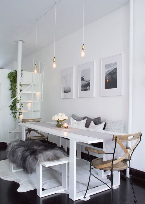 all-white everything with very dark stained wooden floors and a white rug to soften it