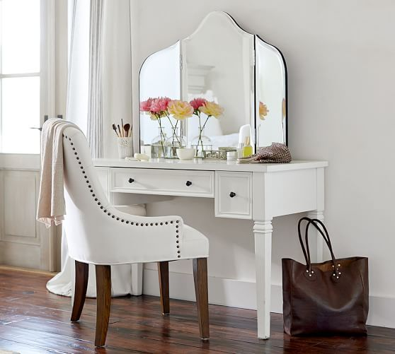 an antique desk painted white with small black knobs - just add a large mirror and you are done
