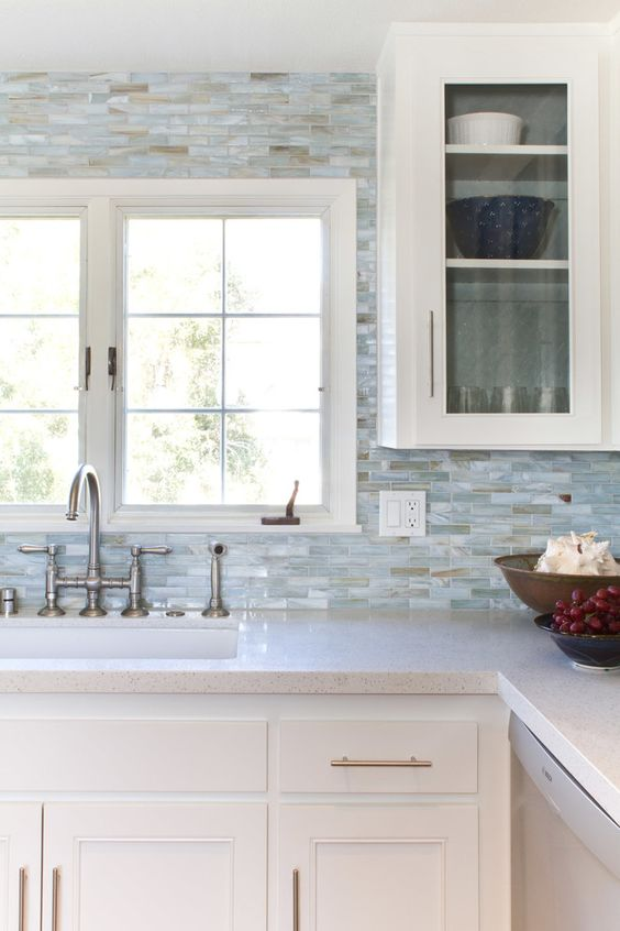 breathtaking mother of pearl tiles in blue shades for a gorgeous kitchen backsplash