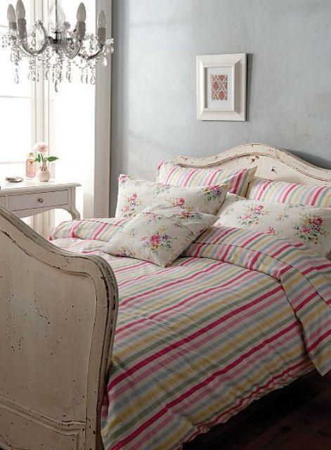 colorful striped vintage-inspired bedding with floral print pillow cases