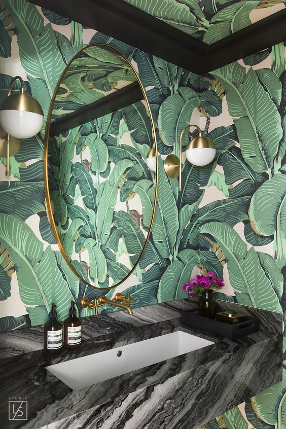 using palm leaf printed wallpaper in a powder room will make it amazing and refined