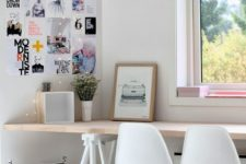18 a Scandinavian workspace for two with a long trestle desk on white legs, which is used instead of a windowsill