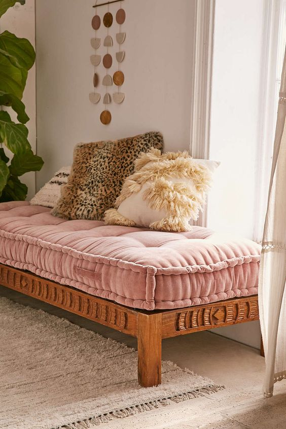 a pink velvet daybed for a boho-inspired girlish space and fluffy fur pillows