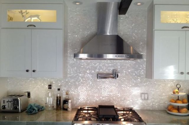 add a glam touch to your kitchen with a gorgeous mother of pearl tile backsplash