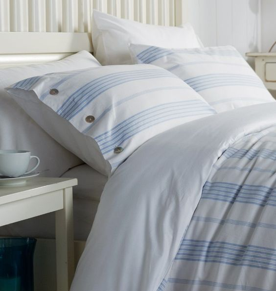 blue and white striped bedding set with buttons for a peaceful coastal bedroom