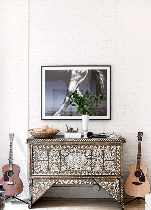 a boho chic wooden sideboard clad with mother of pearl for a creative and unique look