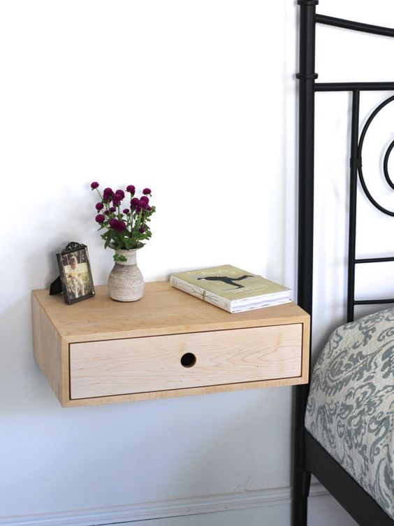 a cute wooden nightstand with a drawer is a great solution for many spaces