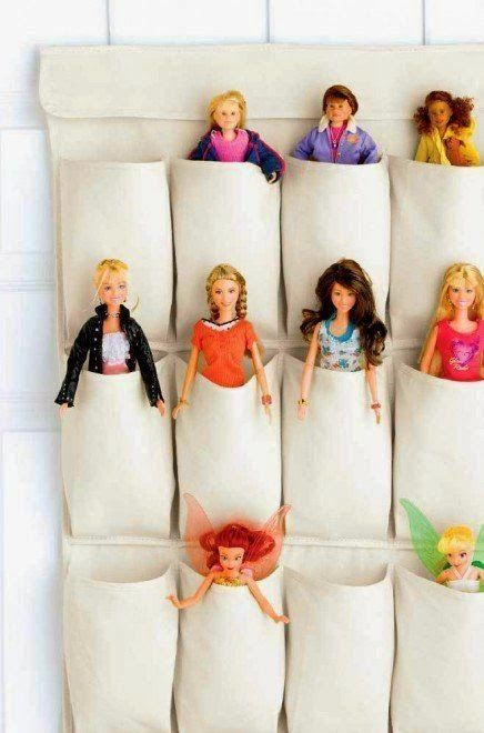 a pocket doll storage attached to the wall is great for a girl's playroom
