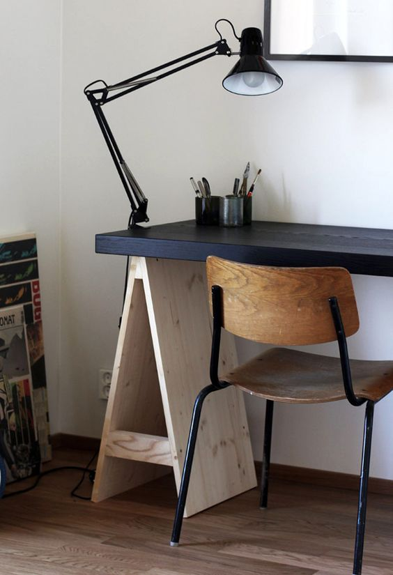 adapt your trestle desk to the style of your space like here   the desktop was painted black to make it look more masculine