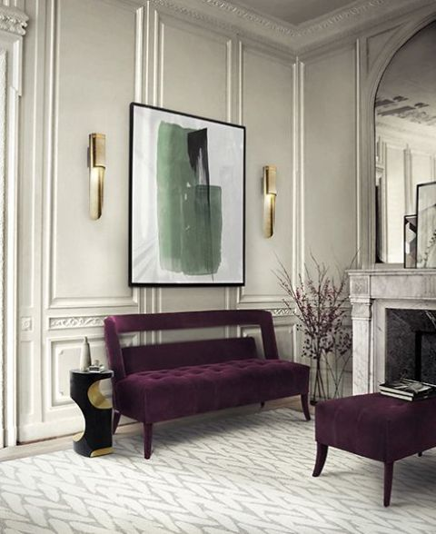 chic refined space with a deep purple bench and ottoman to add color