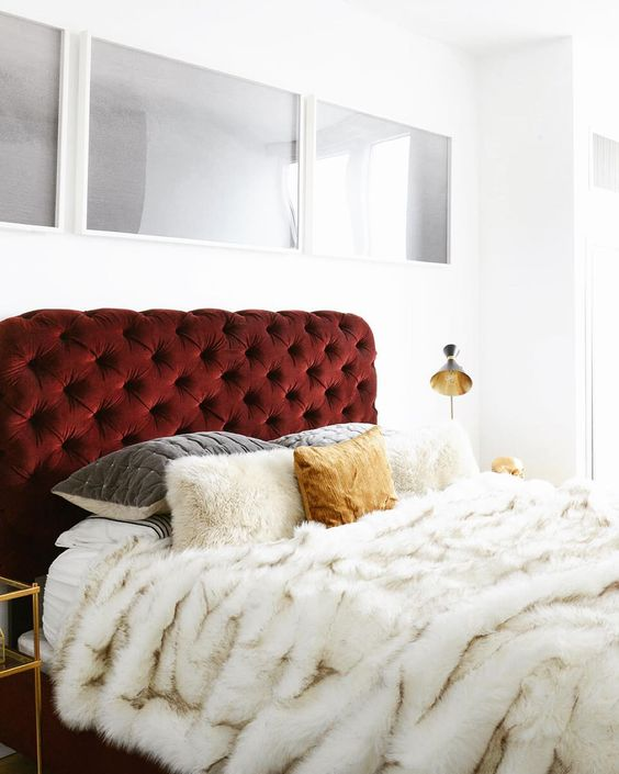 a burgundy velvet upholstered headboard for a luxurious touch in your bedroom