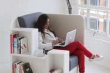 20 a comfy upholstered chair with built-in bookshelves is ideal for any book lover