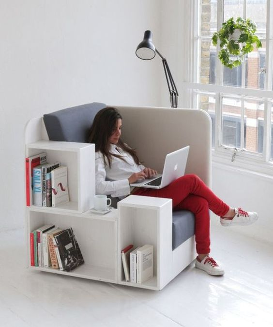 a comfy upholstered chair with built-in bookshelves is ideal for any book lover
