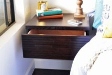 20 a dark stained floating nightstand with a large drawer