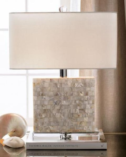 a modern lamp with a base incrusted with mother of pearl looks chic and beautiful