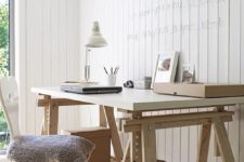 20 a white and light-colored wood trestle desk has additional open storage compartments