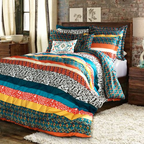 colorful patchwork striped bedding for a rustic, woodland or boho bedroom