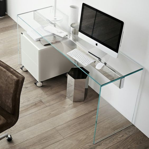 ultra-minimalist home office with a clear glass desk looks disappearing in the air