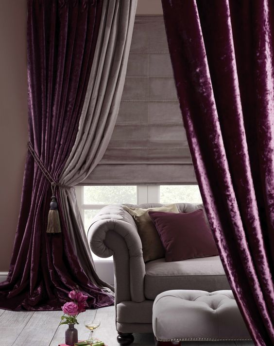 a decadent space can be made more refined and lush with purple velvet curtains