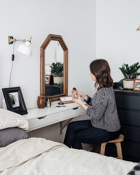 a floating bedside table that doubles as a vanity and has two drawers