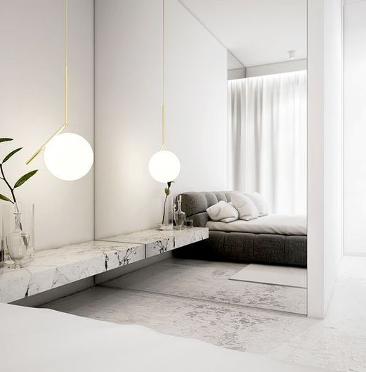 a mirror wall is used to make the laconic bedroom more interesting