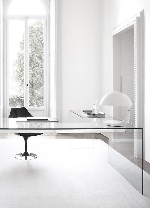 laconic masculine home office needs no more than an L-shaped clear glass desk