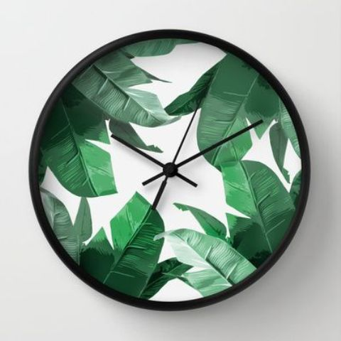 palm leaf print wall clock can be made on your own, you just need some self-adhesive wallpaper