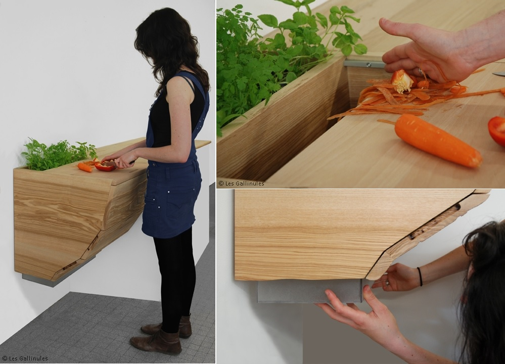 a countertop with a cutting board and a trash can inside