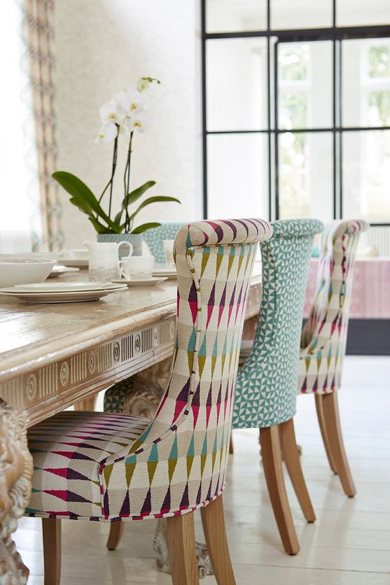 colorful rhomb and triangle upholstered sofa for a boo touch in the dining room