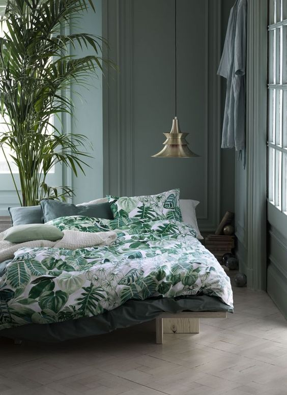 emerald, dark green and white bedding set with a botanical print and plain parts