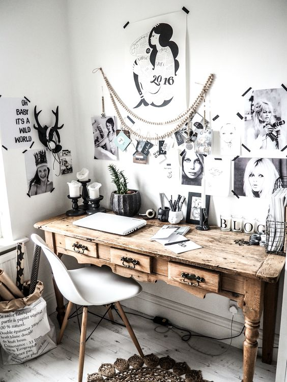 a Scandinavian home office made cozier with a rustic vintage desk with antique handles