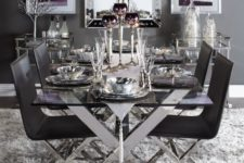 23 a chic table with criss cross metal legs and matching chairs in black for a dramatic dining space