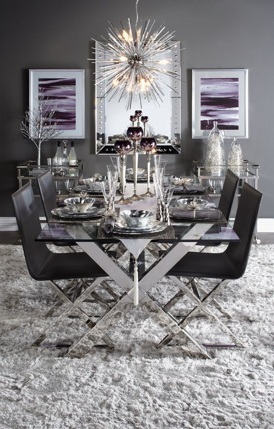 a chic table with criss cross metal legs and matching chairs in black for a dramatic dining space